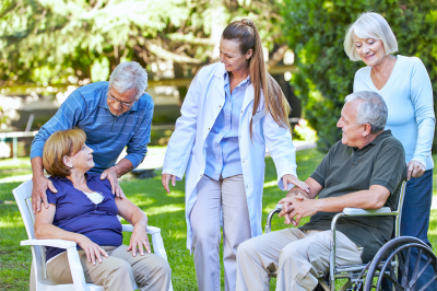 elderly people and caregivers talking